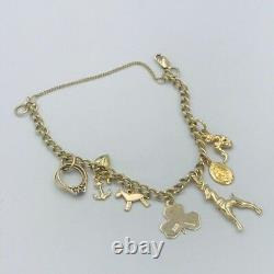 9ct 375 solid Yellow Gold Charm Bracelet Hallmarked with 7 9ct Charms #329