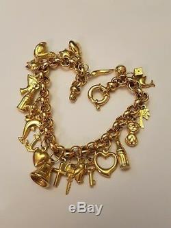 9ct 9k 375 yellow gold 23 charm bracelet nice mint