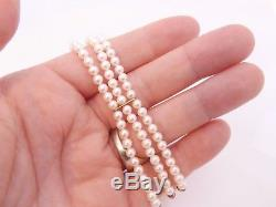 9ct/ 9k gold Diamond clasped three strand cultured Pearl & Ruby bracelet, 375