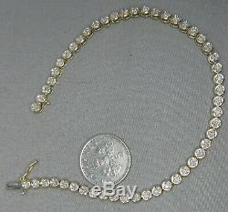 9ct GOLD DIAMOND TENNIS BRACELET 7.25 LONG. A29