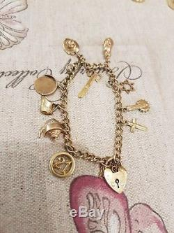 9ct Gold Charm Bracelet With Lots Of Charms. See Pics