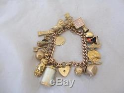 9ct Gold Charm bracelet with 23 9ct Gold Charms, vintage c. 1970's. PHN02360