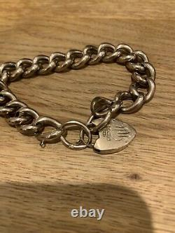 9ct Gold Curb Chain Bracelet With Heart Shaped Clasp. Weight 18.8gms