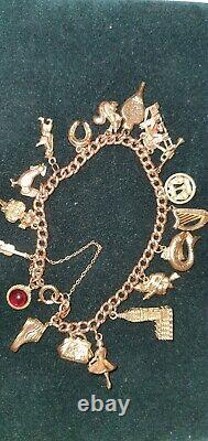 9ct Lovely Gold Charm Bracelet With 19 Smashing Charms