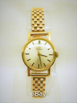 9ct Solid Ladies Gold Omega on Solid 9ct Gold Bracelet