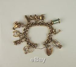 9ct Yellow Gold Charm Bracelet With Love Heart Clasp & Ten Charms