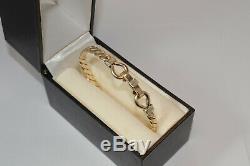 9ct gold torque bangle bracelet 30.5 grams / hook & loop bracelet / 375 gold