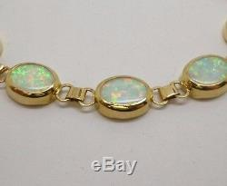 9ct yellow gold 10 stone oval cut white opal 7.5 bracelet with swivel clasp