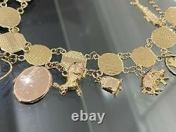 An early 9CT Solid Gold & Thirteen Charm Bracelet 21.40g / 20cm