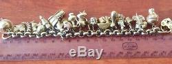 Charm Bracelet 9 ct Gold 73.4 gram 25 Charms Mainly 9ct 14ct 18ct 20.5cm