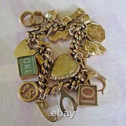 FABULOUS 9ct GOLD FULLY HALLMARKED CHARM BRACELET WEIGHS A HEAVY 38.9g