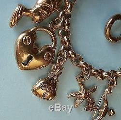 LOVELY 9ct GOLD CHARM BRACELET