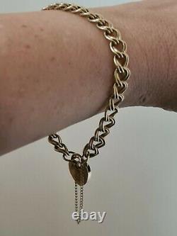 Ladies 9ct solid gold charm bracelet 12 grams