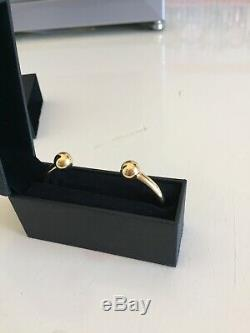 Mens 9ct yellow gold torque bangle