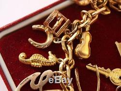 Rolled gold bracelet and solid 9ct yellow gold charms 22.60 grams
