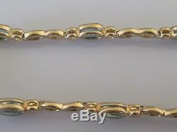 Secondhand 9ct yellow gold multi oval blue topaz round diamond bracelet 7inches
