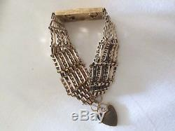 Sovereign gate bracelet. 9ct gold 7 bar bracelet with 22ct Gold sovereign 1978