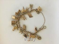 Stunning Vintage 9ct Gold Curb Link Charm Bracelet With 16 Charms 52.52 Grams