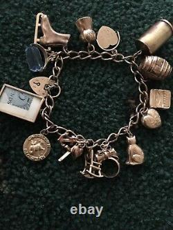 Vintage 9ct gold charm bracelet Weight 33 Grams